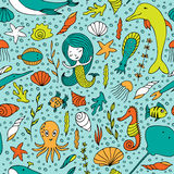 Seamless pattern marine life. Fish, algae, sea animals, seashell, mermaid and bubbles drawn by hand in cartoon style on turquoise background Stock Photos