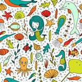 Seamless pattern marine life. Fish, algae, sea animals, seashell, mermaid and bubbles drawn by hand in cartoon style on white background Stock Images