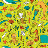 Seamless pattern marine life. Fish, algae, sea animals, seashell, mermaid and bubbles drawn by hand in cartoon style on yellow-green background Stock Photo