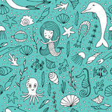 Seamless pattern marine life. Fish and other sea creatures, mermaids and shells hand-painted on a turquoise background Stock Photography