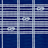 Seamless pattern with marine rope and knots on a blue background Royalty Free Stock Photo