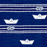 Seamless pattern with marine rope, knots and boats on a blue bac Royalty Free Stock Photo
