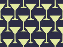 Seamless pattern with a martini glass. Vector Royalty Free Stock Images
