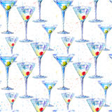 Seamless pattern of a Martini with olive and cherry. Painting of a alcohol drink and splash . Stock Photo