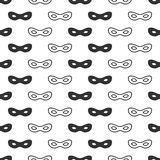 Seamless pattern with mask. Black and white carnival simple design. Superhero mask. Traditional venetian festive Royalty Free Stock Image