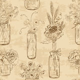 Seamless pattern of mason jars with flowers Stock Images