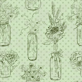 Seamless pattern of mason jars with flowers Royalty Free Stock Photo