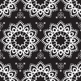Seamless pattern mehndi background with flowers in indian style with lace buta decoration items on black background. Stock Photography