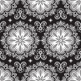 Seamless pattern mehndi background with flowers and lace buta decoration items on black background. Royalty Free Stock Photo