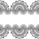 Seamless pattern mehndi Indian borders with mirrored flowers and geometric elements for tattoo. Stock Photo