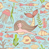 Seamless pattern with mermaid, fishes, coral, shell, seahorse and seaweeds. Royalty Free Stock Photos