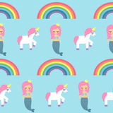Seamless pattern with mermaids, unicorns and rainbows on blue background. Stock Photos