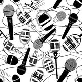 Seamless pattern of microphones Stock Images