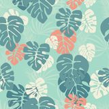 Seamless pattern with monstera palm leaves and plants on blue background Stock Photography