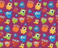 Seamless pattern with monsters. Print for Halloween. Royalty Free Stock Photos