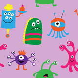 Seamless pattern of monsters on a purple background Royalty Free Stock Image