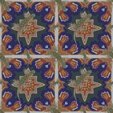 A seamless pattern, in Moroccan design, made of Moroccan tiles, with a salamander. Wallpaper Stock Photography