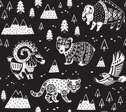 Seamless pattern with mountain animals in monochrome style. Black and white seamless pattern of mountain animals with ethnic, tribal ornaments stock illustration