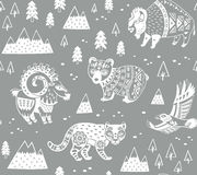 Seamless pattern with mountain animals in monochrome style. Gray and white seamless pattern of mountain animals with ethnic, tribal ornaments vector illustration