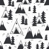 Seamless pattern with mountains, wigwams, fir trees royalty free illustration