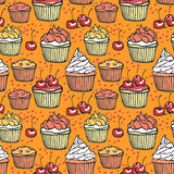 Seamless pattern with muffins and cherries Stock Image