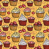 Seamless pattern with muffins and cherries Royalty Free Stock Photography