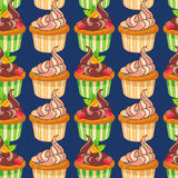 Seamless pattern with muffins. Stock Photos