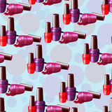 Seamless pattern, multi-colored nail varnish. Royalty Free Stock Image