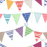Seamless pattern with multicolored bright buntings garlands on w Stock Images