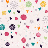 Seamless pattern with multicolored snowflakes. Seamless pattern with multicolored snowflakes, stars and hearts. Hand drawn design for Christmas and New Year Royalty Free Stock Photography