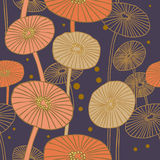 Seamless pattern with mushrooms. Hand drawn background with gold mushrooms on dark background Royalty Free Stock Image