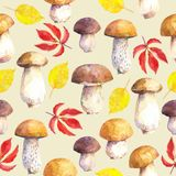 Seamless pattern with mushrooms and leaves on beige background. Hand painted in watercolor vector illustration