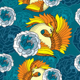 Seamless pattern with Mythological Firebird in orange and chrysanthemums Royalty Free Stock Photo