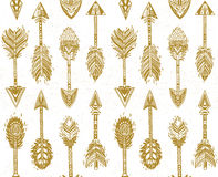 Seamless pattern with Native American Indian arrows in gold Stock Photos