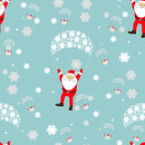Seamless pattern. New Year s Christmas holiday. many Santa Claus flies on a parachute with the girl of dignity and the elf. an ill Stock Photos