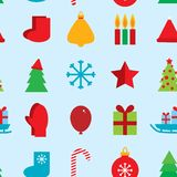 Seamless pattern new year snowflakes, socks,. Mittens, Christmas tree, gifts, sleigh, star, candle on blue background Royalty Free Stock Photos
