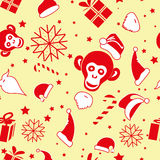 Seamless pattern for new year on yellow background. Wallpaper novogodnii 2016 with toys and a monkey Stock Photos