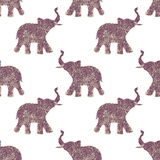 Seamless pattern with nice abstract elephants of glitter. Their trunks raised up - good luck symbol Stock Photos