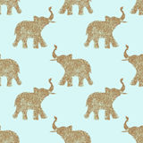 Seamless pattern with nice abstract elephants of glitter. Their trunks raised up - good luck symbol Stock Images