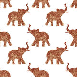 Seamless pattern with nice abstract elephants of glitter. Their trunks raised up - good luck symbol Royalty Free Stock Photos