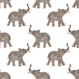 Seamless pattern with nice abstract elephants of glitter. Their trunks raised up - good luck symbol Royalty Free Stock Photography