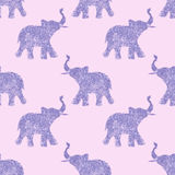 Seamless pattern with nice abstract elephants of glitter. Their trunks raised up - good luck symbol. Violet background Stock Photos