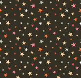 Seamless pattern with night sky and colorful hand drawn stars. Stock Photo