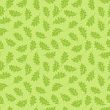 Seamless pattern. Oak leaves on a light green background. It can. Be used for printing on fabric, wallpaper and wrapping Royalty Free Stock Images