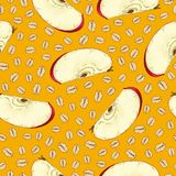 Seamless Pattern with Oat Flakes and Apple Slices. On an Orange Background Royalty Free Stock Photography