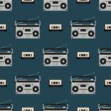 Seamless pattern with old boomboxes and tape cassettes. Vintage music print. Retro vector illustration. Seamless pattern with old boomboxes and tape cassettes royalty free illustration