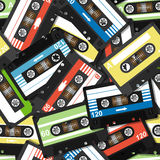 Seamless pattern with old cassettes Stock Photos