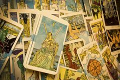 Tarot Cards. Seamless pattern with old colorful Tarot cards in chaotic layout. Occult, esoteric, divination and wicca concept. Mystic and vintage astrology royalty free stock images