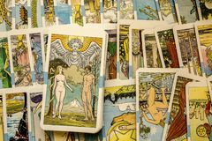 Tarot Cards. Seamless pattern with old colorful Tarot cards in chaotic layout. Occult, esoteric, divination and wicca concept. Mystic and vintage astrology stock photos
