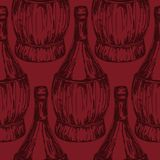 Seamless pattern with old-fashioned wine bottles Stock Photos